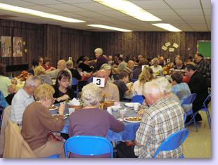 members eating at tables