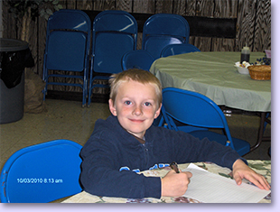 young boy at table