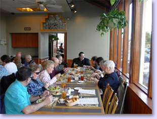 people at tables for early dinner