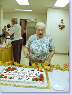 Florence cutting cake