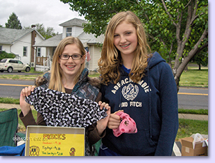 girls selling at flea market