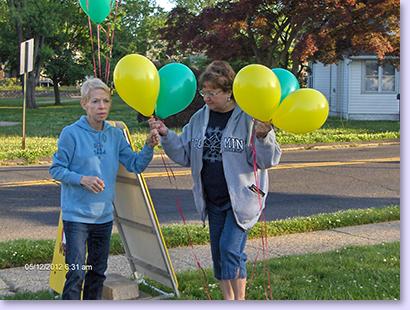 ladies holding balloons