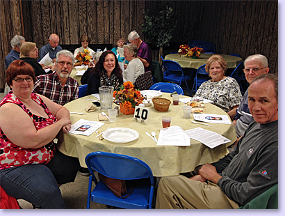 people at tables for church dinner