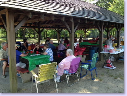 people eating under pavilion