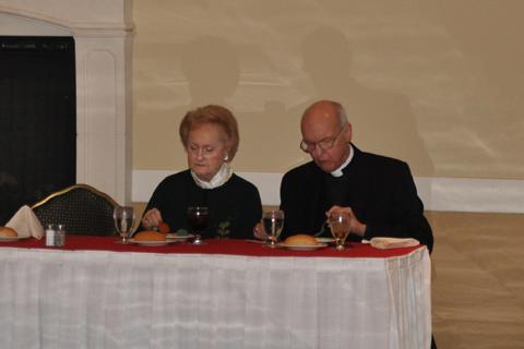 Pastor Ed Schmidt and Pat Schmidt at head table