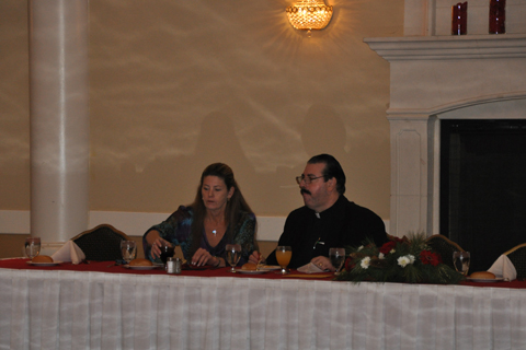 Pastor Andy and wife Amy at head table
